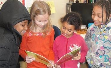 School children reading a story.